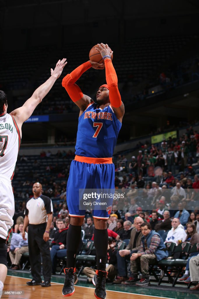 Carmelo Anthony #7 of the New York Knicks shoots against the Milwaukee Bucks on February 3, 2014 at the BMO Harris Bradley Center in Milwaukee, Wisconsin.
