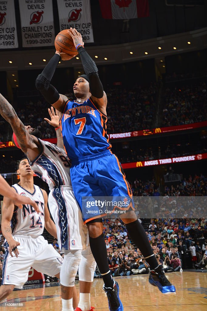<a gi-track='captionPersonalityLinkClicked' href=/galleries/search?phrase=Carmelo+Anthony&family=editorial&specificpeople=201494 ng-click='$event.stopPropagation()'>Carmelo Anthony</a> #7 of the New York Knicks shoots against the New Jersey Nets on April 18, 2012 at the Prudential Center in Newark, New Jersey.
