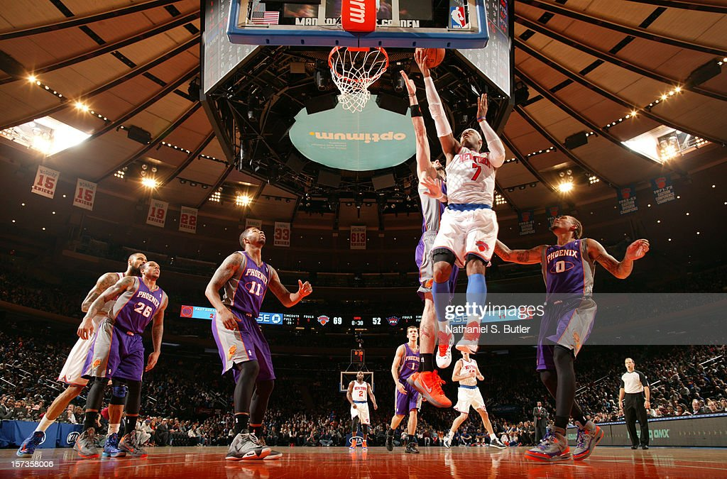<a gi-track='captionPersonalityLinkClicked' href=/galleries/search?phrase=Carmelo+Anthony&family=editorial&specificpeople=201494 ng-click='$event.stopPropagation()'>Carmelo Anthony</a> #7 of the New York Knicks shoots against the Phoenix Suns the on December 2, 2012 at Madison Square Garden in New York City.