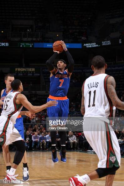 Carmelo Anthony of the New York Knicks shoots against Tobias Harris of the Milwaukee Bucks during the game on November 28 2012 at the BMO Harris...