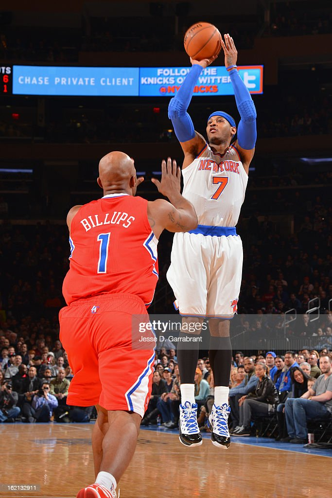 Carmelo Anthony #7 of the New York Knicks shoots over Chauncey Billups #1 of the Los Angeles Clippers on February 10, 2013 at Madison Square Garden in New York City.