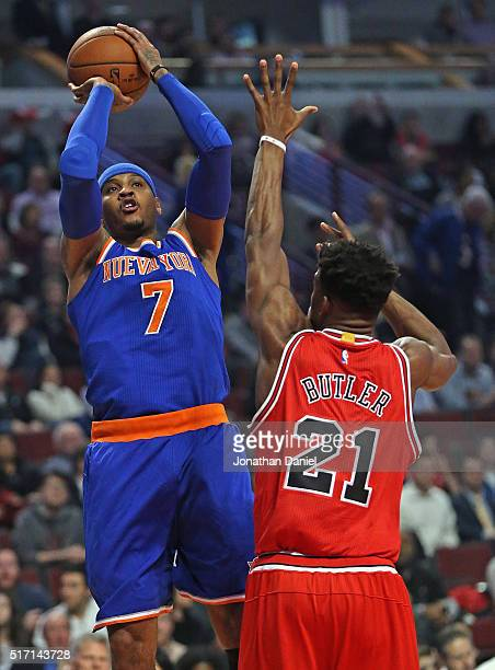 Carmelo Anthony of the New York Knicks shoots over Jimmy Butler of the Chicago Bulls at the United Center on March 23 2016 in Chicago Illinois NOTE...