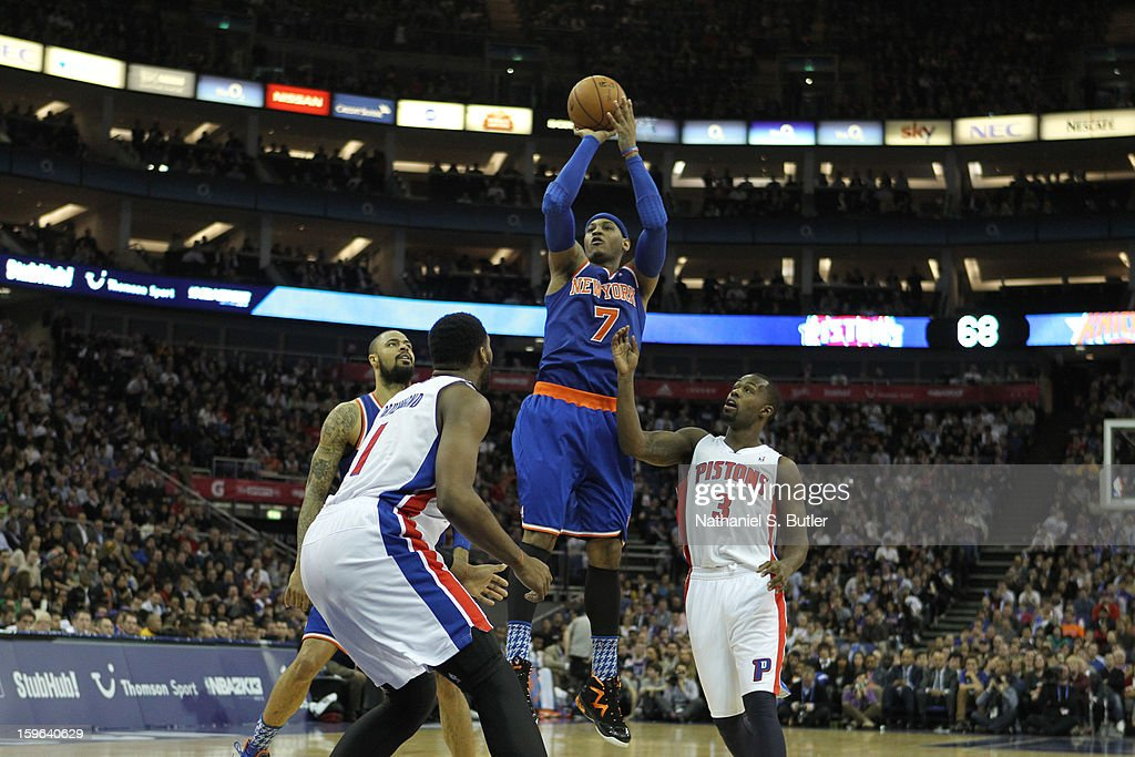 Carmelo Anthony #7 of the New York Knicks shoots over Rodney Stuckey #3 of the Detroit Pistons and Andre Drummond #1 of the Detroit Pistons during a game between the New York Knicks and the Detroit Pistons at the 02 Arena on January 17, 2013 in London, England.