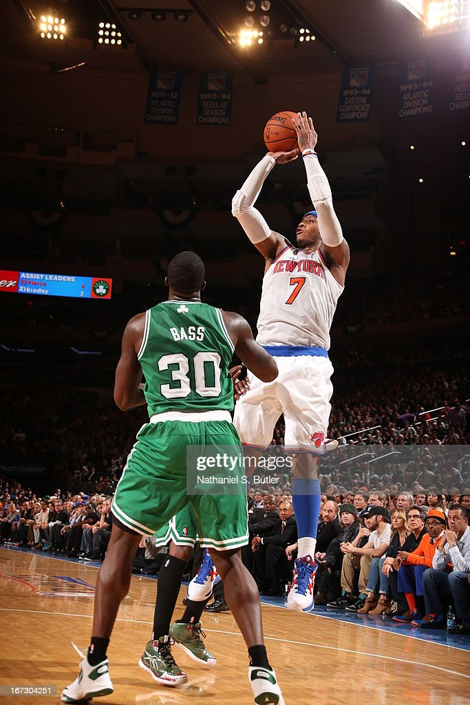 Carmelo Anthony #7 of the New York Knicks shoots the ball against Brandon Bass #30 of the Boston Celtics in Game Two of the Eastern Conference Quarterfinals during the 2013 NBA Playoffs on April 23, 2013 at Madison Square Garden in New York City.
