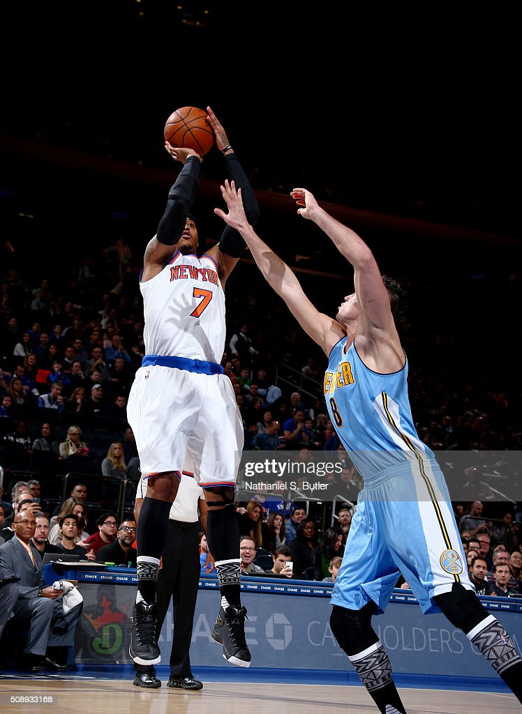 <a gi-track='captionPersonalityLinkClicked' href=/galleries/search?phrase=Carmelo+Anthony&family=editorial&specificpeople=201494 ng-click='$event.stopPropagation()'>Carmelo Anthony</a> #7 of the New York Knicks shoots the ball during the game against the Denver Nuggets on February 7, 2016 at Madison Square Garden in New York City, New York.