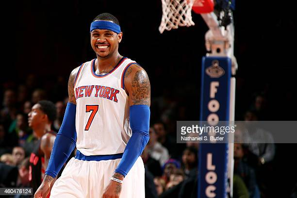 Carmelo Anthony of the New York Knicks smiles during a game against the Toronto Raptors at Madison Square Garden on December 14 2014 in New York City...