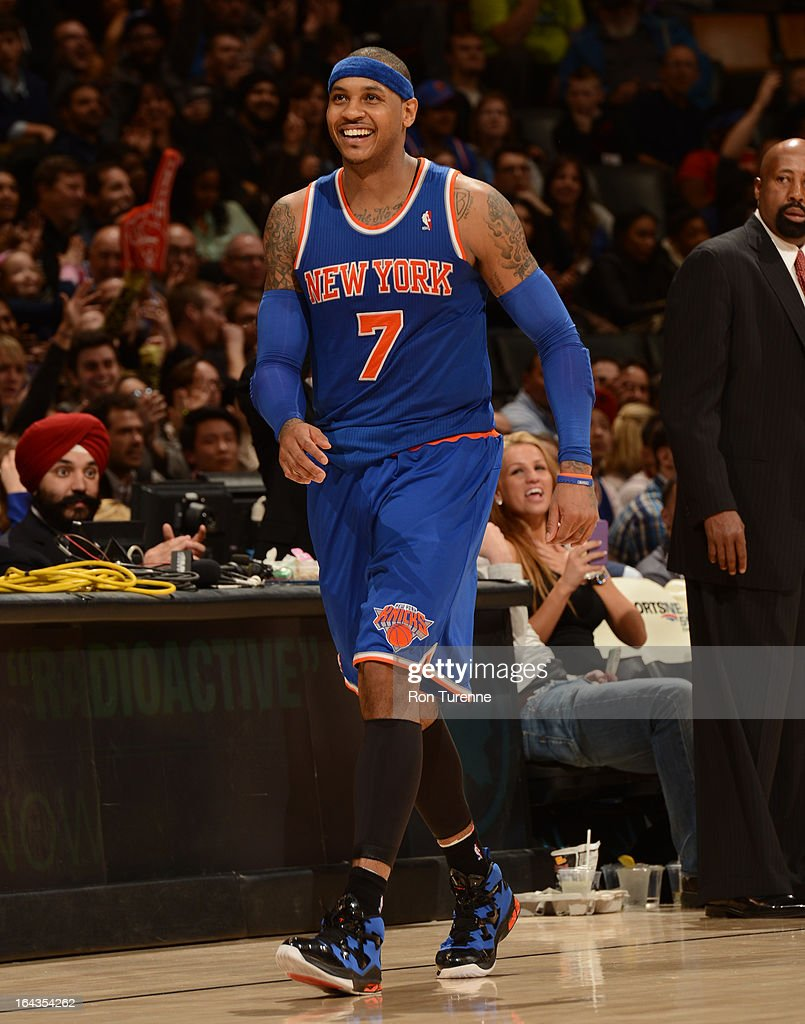 <a gi-track='captionPersonalityLinkClicked' href=/galleries/search?phrase=Carmelo+Anthony&family=editorial&specificpeople=201494 ng-click='$event.stopPropagation()'>Carmelo Anthony</a> #7 of the New York Knicks smiles during the game against the Toronto Raptors on March 22, 2013 at the Air Canada Centre in Toronto, Ontario, Canada.