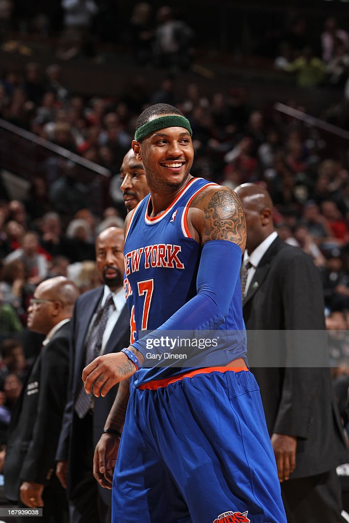 Carmelo Anthony #7 of the New York Knicks smiles during the game against the Chicago Bulls on April 11, 2013 at the United Center in Chicago, Illinois.
