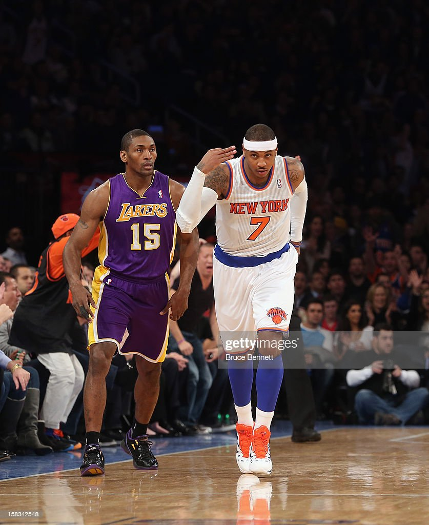 Carmelo Anthony #7 of the New York Knicks starts off the game against the Los Angeles Lakers with a three pointer at Madison Square Garden on December 13, 2012 in New York City.