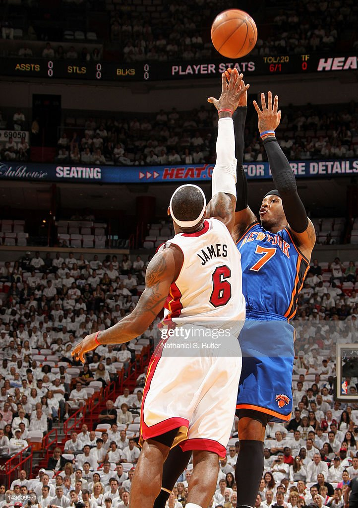 Carmelo Anthony #7 of the New York Knicks takes a jump shot over LeBron James #6 of the Miami Heat in Game Two of the Eastern Conference Quarterfinals during the 2012 NBA Playoffs on April 30, 2012 at American Airlines Arena in Miami, Florida.