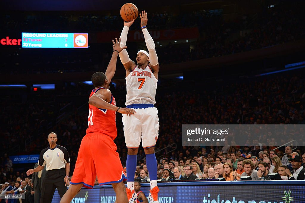 Carmelo Anthony #7 of the New York Knicks takes a jumper vs Thaddeus Young #21 of the Philadelphia 76ers on November 4, 2012 at Madison Square Garden in New York City.