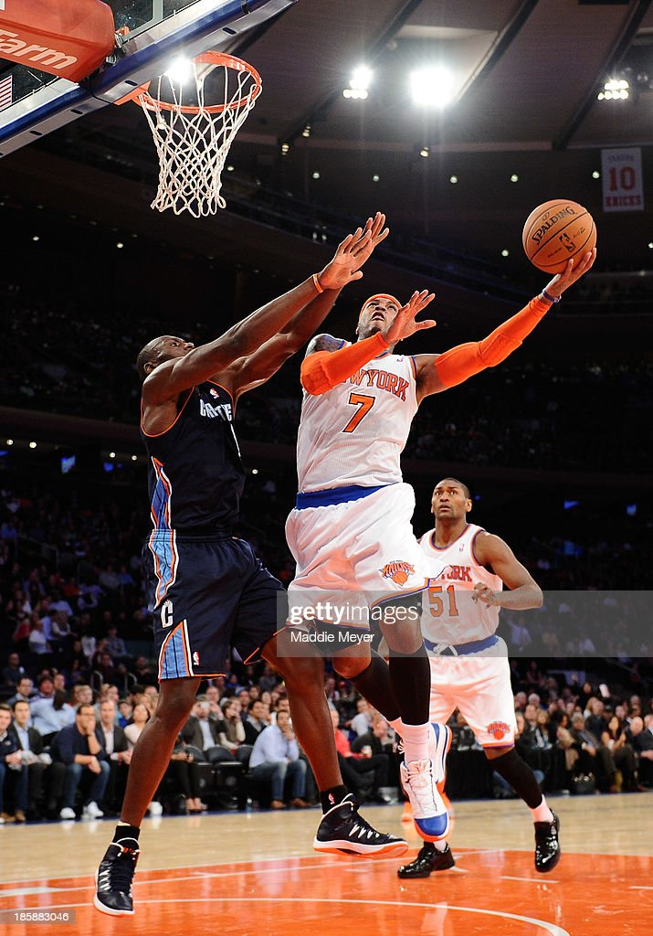 Carmelo Anthony #7 of the New York Knicks takes a shot during the fourth quarter against the Charlotte Bobcats at Madison Square Garden on October 25, 2013 in New York City.