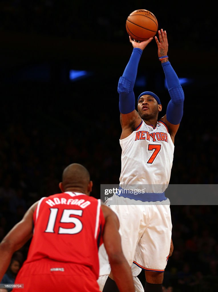 Carmelo Anthony #7 of the New York Knicks takes a shot over Al Horford #15 of the Atlanta Hawks on January 27, 2013 at Madison Square Garden in New York City. The New York Knicks defeated the Atlanta Hawks 106-104.