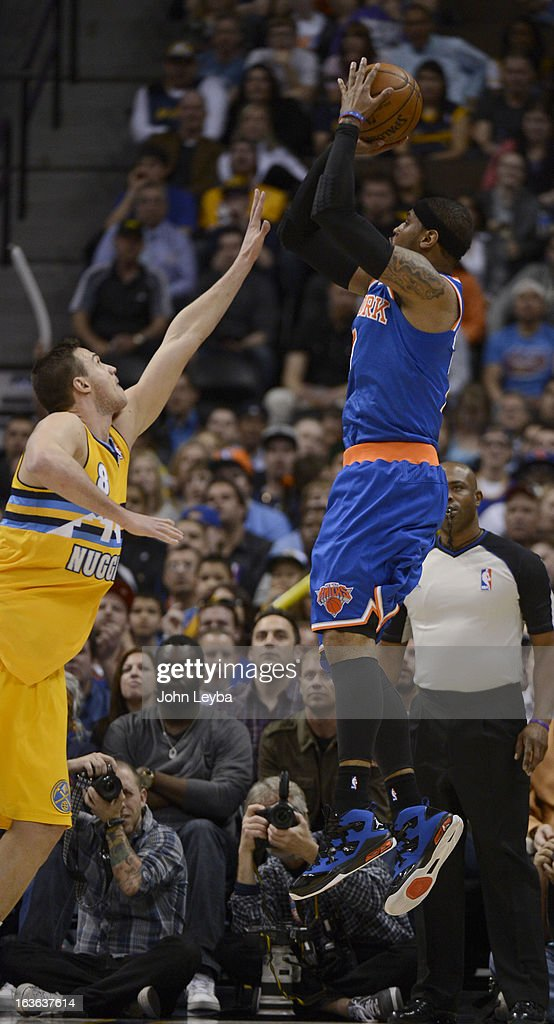 Carmelo Anthony (7) of the New York Knicks takes a shot over Danilo Gallinari (8) of the Denver Nuggets during the first quarter March 13, 2013 at Pepsi Center.