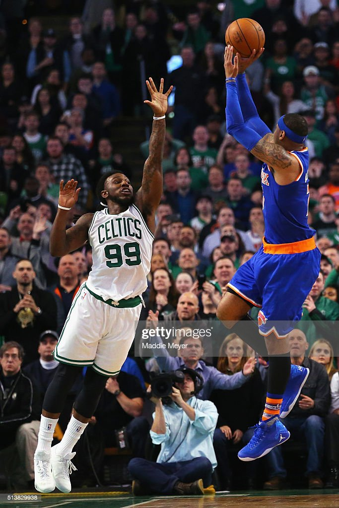 Carmelo Anthony of the New York Knicks takes a shot over Jae Crowder of the Boston Celtics during the fourth quarter at TD Garden on March 4 2016 in...