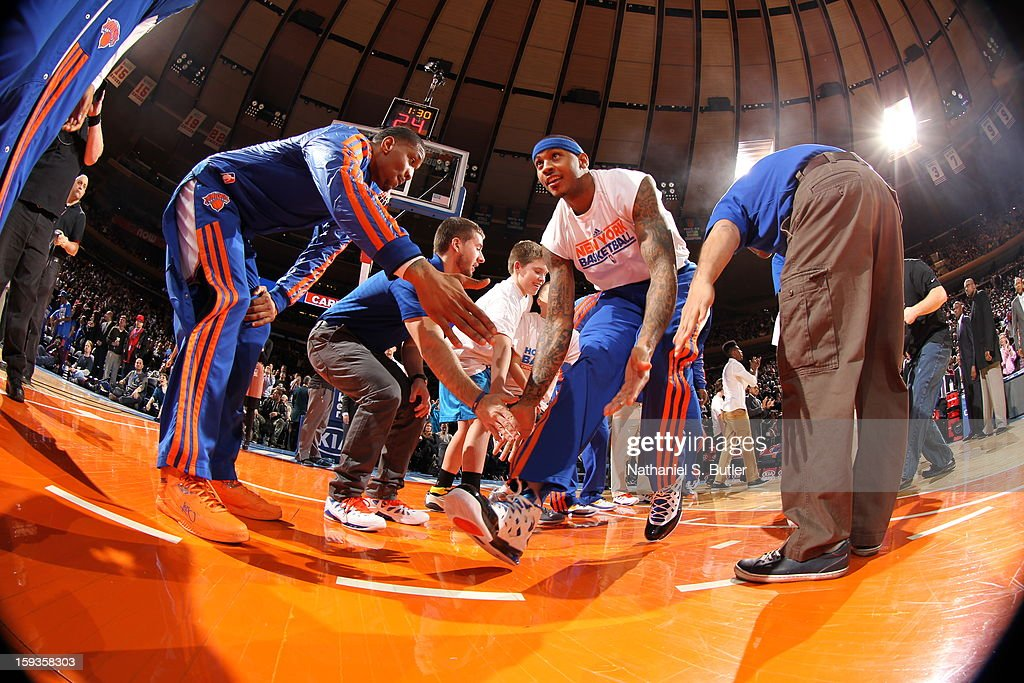 <a gi-track='captionPersonalityLinkClicked' href=/galleries/search?phrase=Carmelo+Anthony&family=editorial&specificpeople=201494 ng-click='$event.stopPropagation()'>Carmelo Anthony</a> #7 of the New York Knicks takes the court during the starting line-up announcements against the Boston Celtics on January 7, 2013 at Madison Square Garden in New York City.