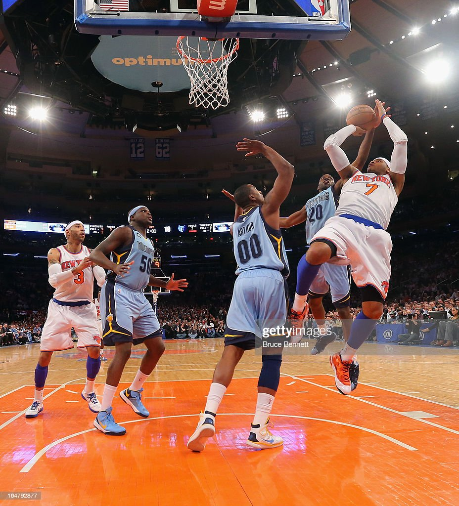 Carmelo Anthony #7 of the New York Knicks takes the shot against the Memphis Grizzlies at Madison Square Garden on March 27, 2013 in New York City. The Knicks defeated the Grizzlies 108-101.