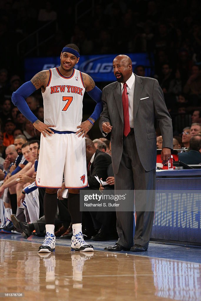 Carmelo Anthony #7 of the New York Knicks talks over the game with Knicks Head Coach Mike Woodson on February 10, 2013 in a game between the Los Angeles Clippers and the New York Knicks at Madison Square Garden in New York City.