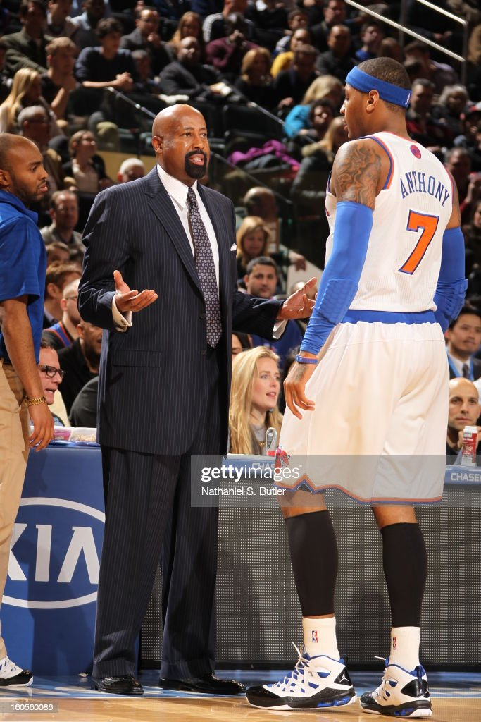 Carmelo Anthony #7 of the New York Knicks talks to Head Coach Mike Woodson during the game against the Sacramento Kings on February 2, 2013 at Madison Square Garden in New York City.