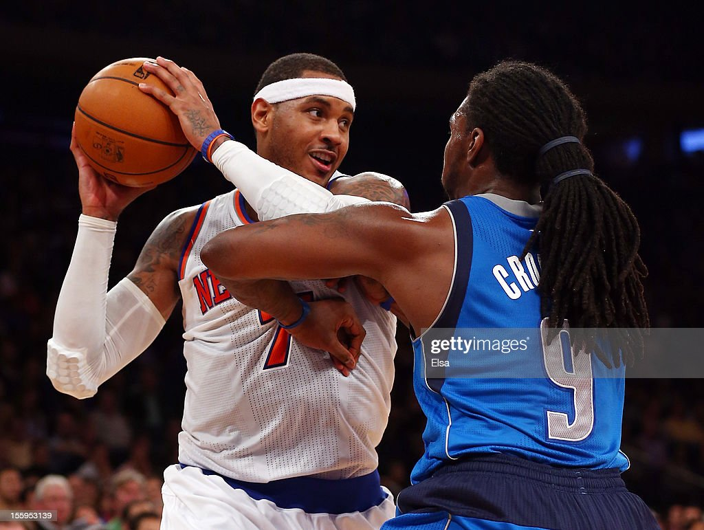 Carmelo Anthony #7 of the New York Knicks tries to get around Jae Crowder #9 of the Dallas Mavericks on November 9, 2012 at Madison Square Garden in New York City.The New York Knicks defeated the Dallas Mavericks 104-94.