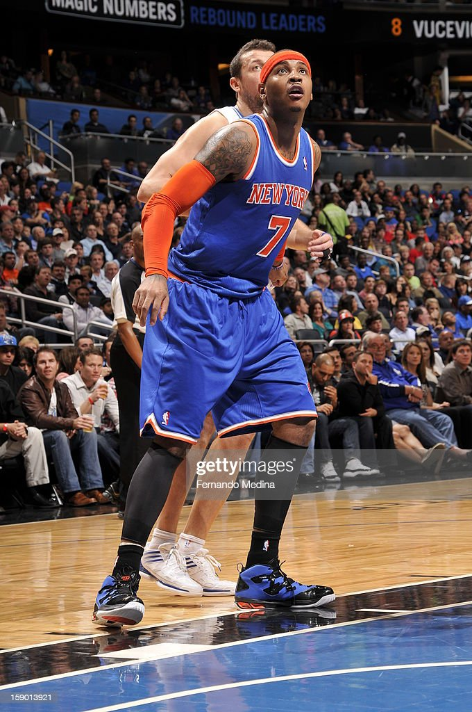 Carmelo Anthony #7 of the New York Knicks waits for the rebound against the Orlando Magic during the game on January 5, 2013 at Amway Center in Orlando, Florida.
