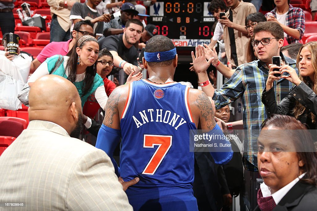 <a gi-track='captionPersonalityLinkClicked' href=/galleries/search?phrase=Carmelo+Anthony&family=editorial&specificpeople=201494 ng-click='$event.stopPropagation()'>Carmelo Anthony</a> #7 of the New York Knicks walks off the court after the game against the Miami Heat on April 2, 2013 at American Airlines Arena in Miami, Florida.