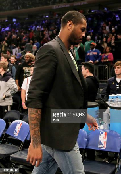 Carmelo Anthony of the New York Knicks walks off the court after the game against the Boston Celtics at Madison Square Garden on April 2 2017 in New...