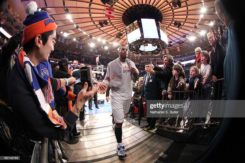 Carmelo Anthony #7 of the New York Knicks walks to the locker room after the game against the Detroit Pistons on February 4, 2013 at Madison Square Garden in New York City.
