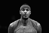 Carmelo Anthony of the New York Knicks warms up before their game against the Charlotte Hornets at Time Warner Cable Arena on November 11 2015 in...