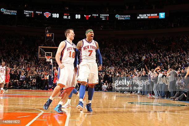 Carmelo Anthony of the New York Knicks who has hit two last second shots to win in overtime celebrates victory with Steve Novak of the New York...