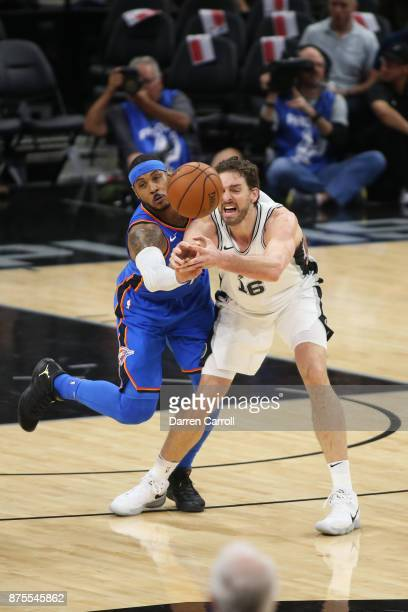 Carmelo Anthony of the Oklahoma City Thunder and Pau Gasol of the San Antonio Spurs go for the ball on November 17 2017 at the ATT Center in San...