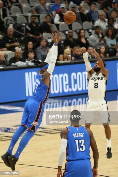 Carmelo Anthony of the Oklahoma City Thunder blocks as Patty Mills of the San Antonio Spurs shoots the ball on November 17 2017 at the ATT Center in...