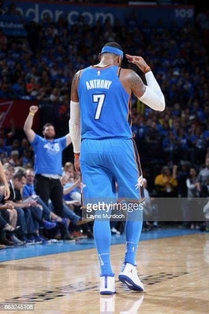 Carmelo Anthony of the Oklahoma City Thunder celebrates during the game against the New York Knicks on October 19 2017 at Chesapeake Energy Arena in...