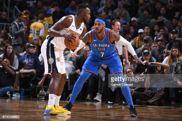 Carmelo Anthony of the Oklahoma City Thunder defends against Paul Millsap of the Denver Nuggets on November 9 2017 at the Pepsi Center in Denver...