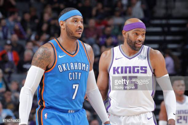 Carmelo Anthony of the Oklahoma City Thunder faces off against Vince Carter of the Sacramento Kings on November 7 2017 at Golden 1 Center in...