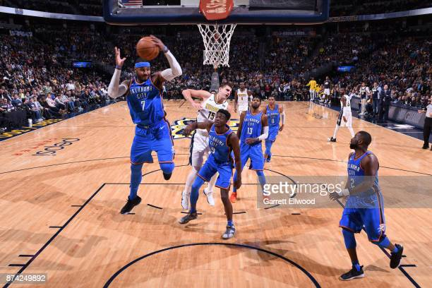 Carmelo Anthony of the Oklahoma City Thunder grabs the rebound against the Denver Nuggets on November 9 2017 at the Pepsi Center in Denver Colorado...
