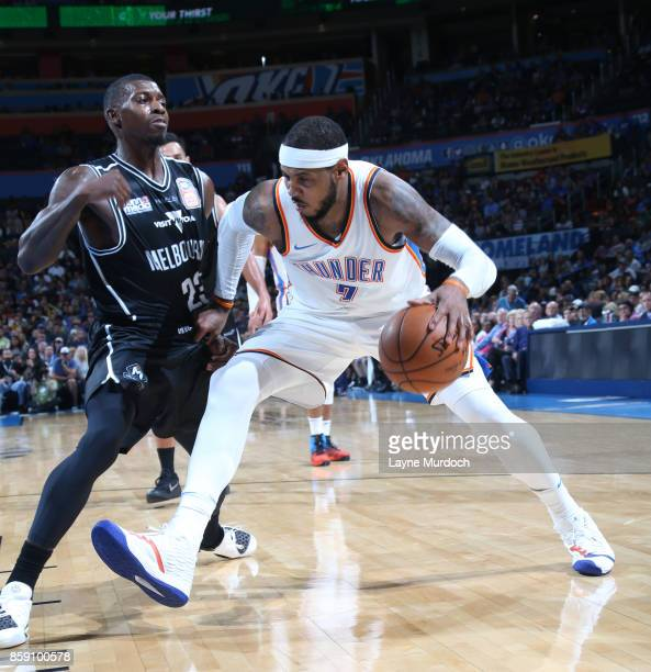 Carmelo Anthony of the Oklahoma City Thunder handles the ball against Casey Prather of the Melbourne United during the preseason game on October 8...
