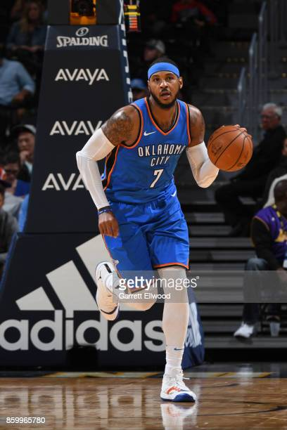 Carmelo Anthony of the Oklahoma City Thunder handles the ball against the Denver Nuggets on October 10 2017 at the Pepsi Center in Denver Colorado...