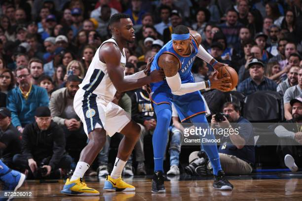 Carmelo Anthony of the Oklahoma City Thunder handles the ball against Paul Millsap of the Denver Nuggets on November 9 2017 at the Pepsi Center in...