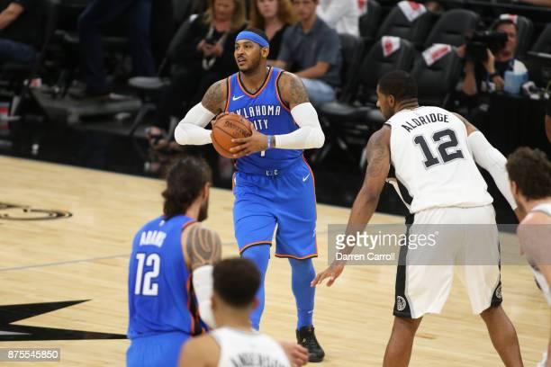 Carmelo Anthony of the Oklahoma City Thunder handles the ball against the San Antonio Spurs on November 17 2017 at the ATT Center in San Antonio...