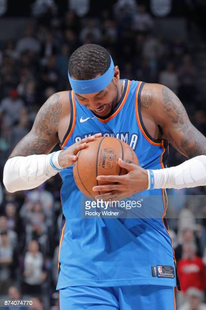 Carmelo Anthony of the Oklahoma City Thunder holds onto the ball against the Sacramento Kings on November 7 2017 at Golden 1 Center in Sacramento...