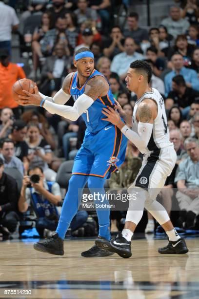 Carmelo Anthony of the Oklahoma City Thunder jocks for a position San Antonio Spurs on November 17 2017 at the ATT Center in San Antonio Texas NOTE...