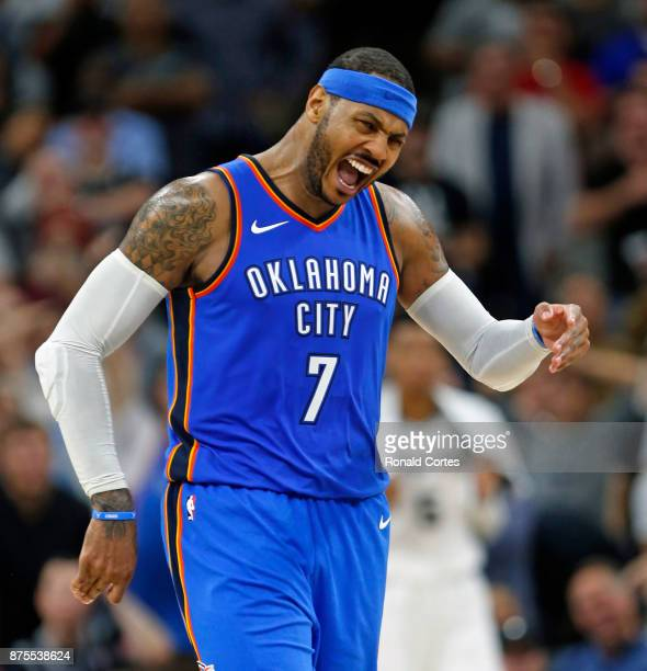 Carmelo Anthony of the Oklahoma City Thunder reacts after he thought he hit a three to tie the game against the San Antonio Spurs but it was ruled a...