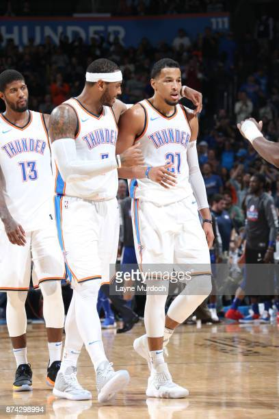 Carmelo Anthony of the Oklahoma City Thunder speaks with Andre Roberson of the Oklahoma City Thunder during the game against the LA Clippers on...