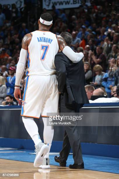 Carmelo Anthony of the Oklahoma City Thunder speaks with head coach Billy Donovan during the game against the LA Clippers on November 10 2017 at...