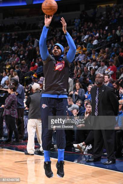 Carmelo Anthony of the Oklahoma City Thunder warms up before the game against the Denver Nuggets on November 9 2017 at the Pepsi Center in Denver...
