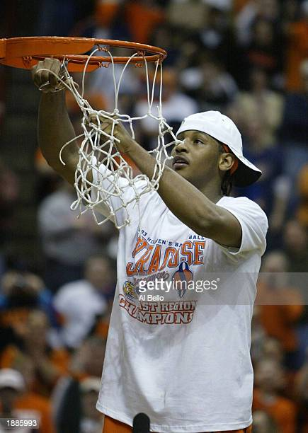 Carmelo Anthony of the Syracuse Orangemen cuts down the net after defeating the Oklahoma Sooners 6347 during the East Regionals of the NCAA...