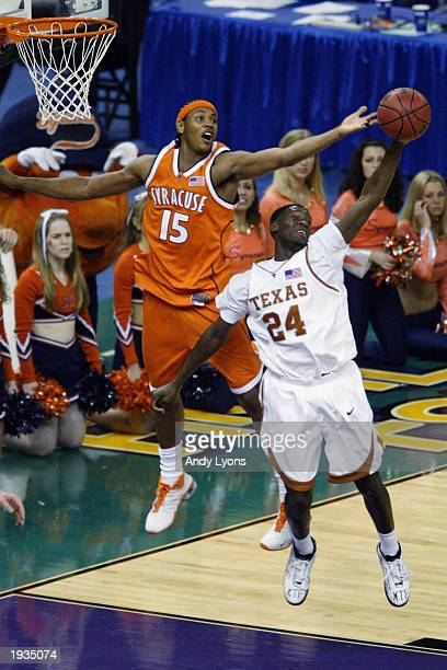 Carmelo Anthony of the Syracuse University Orangeman and Royal Ivey of the University of Texas at Austin Longhorns attempt to rebound during the...