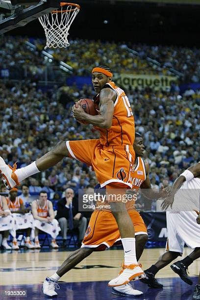 Carmelo Anthony of the Syracuse University Orangeman rebounds against the University of Texas at Austin Longhorns during the semifinal round of the...