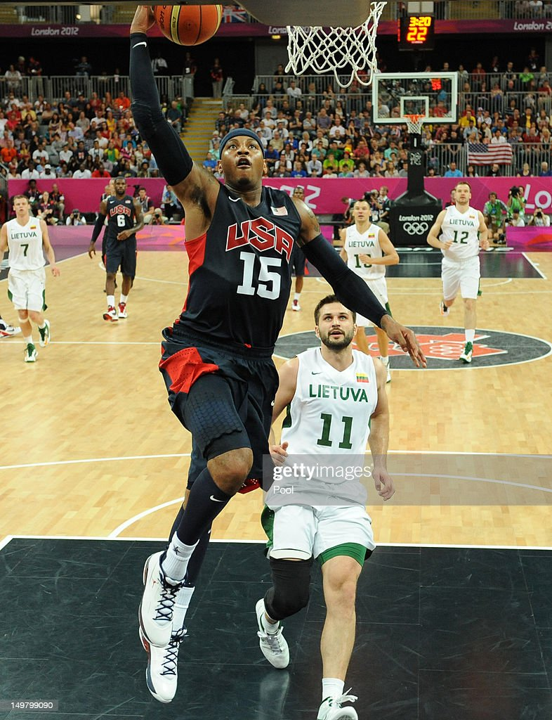 Carmelo Anthony (L) of the United States goes to the basket against Linas Kleiza of Lithuania during the Men's Basketball Preliminary Round match between Lithuania and the United States on Day 8 of the London 2012 Olympic Games at Basketball Arena on August 4, 2012 in London, England.